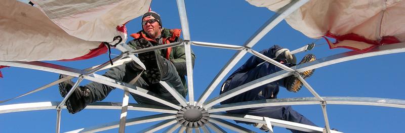 """Setting up the large dome tent.<br /> <br /> Opsætning af et af de store kuppeltelte.<br /> <br /> Photo: Jim Hedfors (Swedish Geotechnical Institute), NEEM ice core drilling project,  <a href=""""http://www.neem.ku.dk"""">http://www.neem.ku.dk</a>"""
