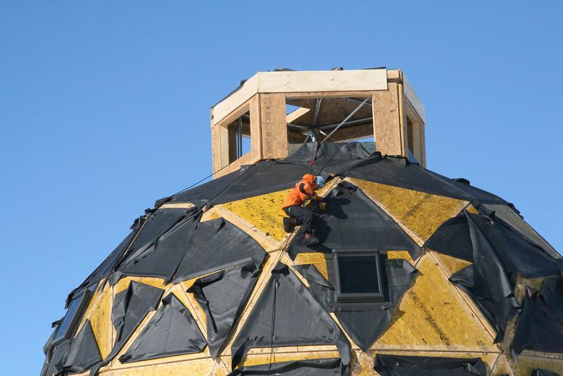 Alone on the top of main dome. <br /> <br /> Alene på toppen af hovedbygningen.<br /> Photo: Dorthe Dahl-Jensen