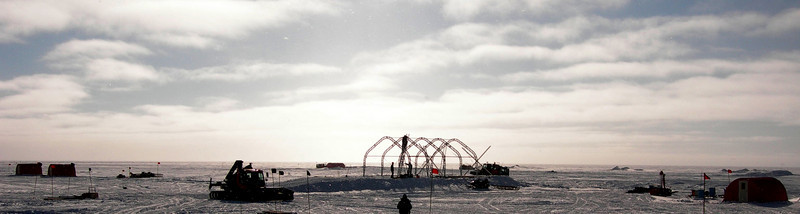 "Getting the garage tents up. <br /> <br /> Opsætning af garageteltene.<br /> <br /> Photo: Jim Hedfors (Swedish Geotechnical Institute), NEEM ice core drilling project,  <a href=""http://www.neem.ku.dk"">http://www.neem.ku.dk</a>"