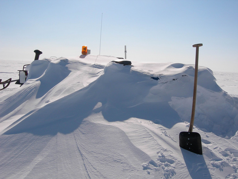 "The Flexmobile needs a bit of snow clearing.<br /> <br /> Bæltekøretøjet skal lige skovles fri.<br /> <br /> Photo: Jim Hedfors (Swedish Geotechnical Institute), NEEM ice core drilling project,  <a href=""http://www.neem.ku.dk"">http://www.neem.ku.dk</a>"