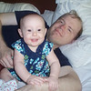 Kaylie & Daddy playing on the bed
