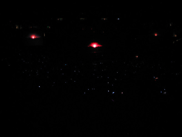 """All those little lights are peoples cameras recording the opening. So much for lighters these days. Cameras or cell phones are the new """"in"""" thing (lame)."""