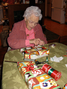 Great Grandma Ginia wraps packages
