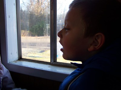 Noah trying to see his breath on the train