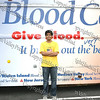 Zafir Mowla, student chair of the blood drive, outside the New York Blood Center mobile unit.