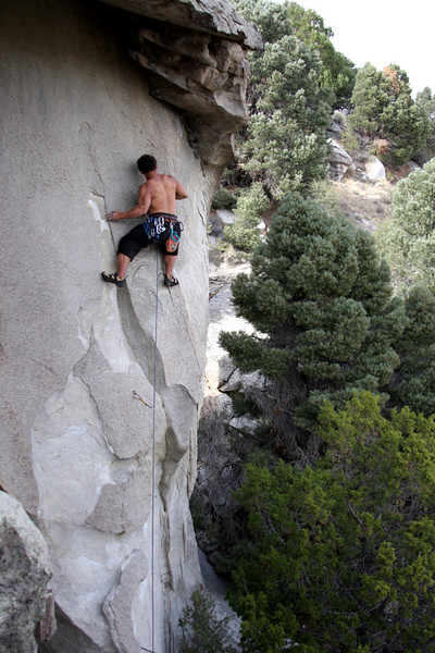 Kelsey strains through some tough moves on <i>Liberator of Baghdad 5.12c/d</i>.