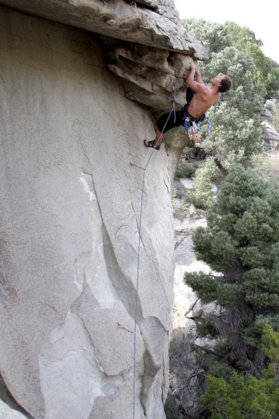 The crux eventually falls below Kelsey as he pulls through the roof on <i>Liberator of Baghdad 5.12c/d</i>.