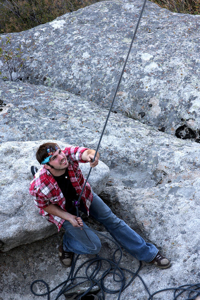 Richard sits attentively at the belay.