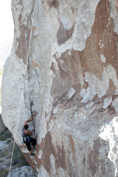 Kelsey pulls through the first moves of <i>Electric Avenue 5.12</i>.