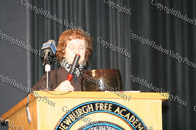 Patricia Hunt-Perry rings the Bell of Peace during The 15th annual Martin Luther King, Jr Community-Wide Celebration's annual program at Newburgh Free Academy.