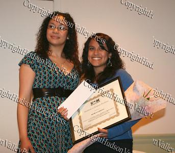 Christina Ramos presents Monica Landron with her scholarship award
