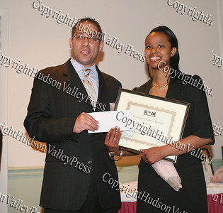 John Larregui presents Shiann Mayorga with her scholarship award