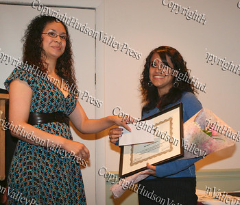 Christina Ramos presents Monica Landron with her scholarship award
