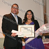 John Larregui presents Michelle Matias-Cortes with her scholarship award
