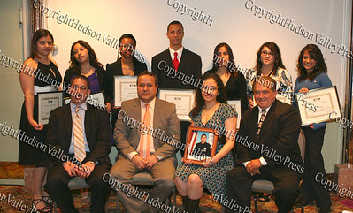 Scholarship award winners (standing)Jessica Orrego, Michelle Matias-Cortes, Shiann Mayorga, Ramon Santos, Lia Zelada, Miriam Montes and Monica Landron. Seated John Larregui of Verizon Wireless, Carlos Campuzano of Ulster Savings Bank, Christina Ramos of Cabana Spanish Restaurant and R&M Promotions CEO Edwin Ramirez, Sr.,