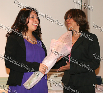 Michelle Matias-Cortes receives flowers from Norma Ramirez
