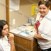 Carolyn Saldana with Ms Duclet-Rivera demonstrate how simple the HIV/AIDS test is to take