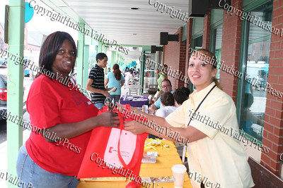 Patricia Hayes receives a bag from Maribel Alicea of Affinity