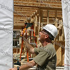 """Clive Rainey, the first volunteer of Habitat for Humanity International, joined in the work at the Newburgh site on Dubois Street on day 1. It was Rainey who first introduced the concept of """"sweat equity"""" to Habitat."""