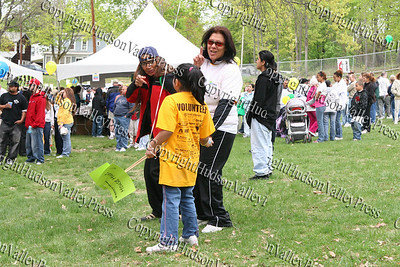 Juanita Colon and Pilar Arauco enjoy music in Downing Park by The Soul Custody Band prior to the walk.