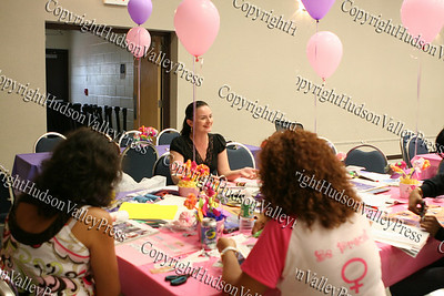 "Workshop facilitator Danielle Jasmine leads a poetry reading followed by creating art collages that focus on teh empowerment of young girls and women during the ""How to be Proud"" conference."