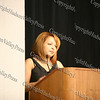 """The event Madrina/Godmother Lisette Alvarez offers words of encouragement to those attending the """"How to be Proud"""" conference."""