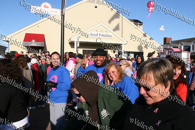 """Newburgh Free Academy history teacher and actor Torrance Harvey gives a """"peace sign"""" as he walks with over 10,000 people at the American Cancer Society's Making Strides Against Breast Cancer 5k walk at Woodbury Common Premium Outlets on Sunday, October 19, 2008."""