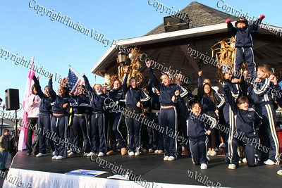 The Elite Cheerleaders perform on stage prior to the American Cancer Society's Making Strides Against Breast Cancer 5K walk at Woodbury Common Premium Outlets on Sunday, October 19, 2008.