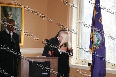 Nicholas hugs wife Sue Valentine after swearing in