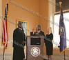 Judge B Harold Ramsey administers the oath of office to Nicholas Valentine Sue