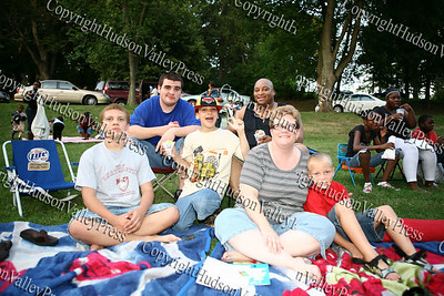 "Kevyn, Alex, Jordan, Edwin, Susan and Perry McCallop await the showing of the ""Bee Movie"" in Downing Park on Tuesday, July 29, 2008."