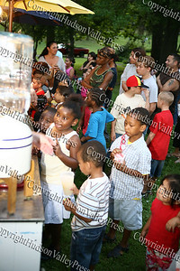 "Children line up at the lemonade stand prior to City of Newburgh Youth Bureau presenting the ""Bee Movie"" in Downing Park on Tuesday, July 29, 2008."