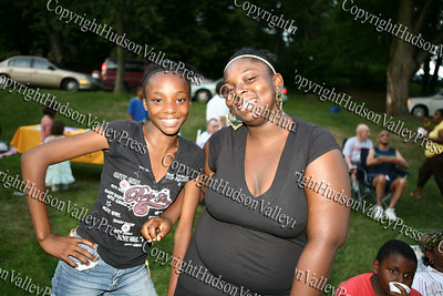 "Shantanice Tallie and Shatavious Cooper pose for a picture prior to the showing of the ""Bee Movie"" in Downing Park on Tuesday, July 29, 2008."
