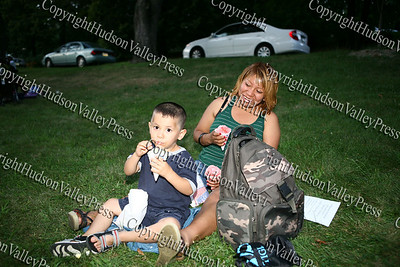 """Three-year-old Aerial enjoys a sno cone as the City of Newburgh Youth Bureau presented the """"Bee Movie"""" in Downing Park on Tuesday, July 29, 2008."""