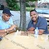 Barry Thompson and Stan Vandervort play chess at the Ebenezer Baptist Church location of National Night Out in Newburgh.