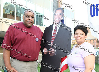 Fred Cook and Sonia Ayala, Barack Obama delegates, pose with a cut out of the democratic presidential candidate during Newburgh's National Night Out.