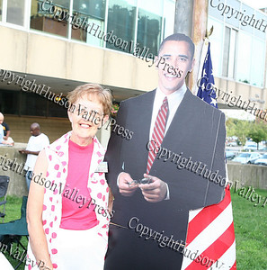 Barack Obama supporter takes a picture with a cut out of the presidential candidate at the Orange County Democratic Committee's table during National Night Out in Newburgh at the library.