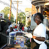 Deborah Franklin cooks up hot dogs and hamburger's at Living in Jesus Ministries during Newburgh's National Night Out.