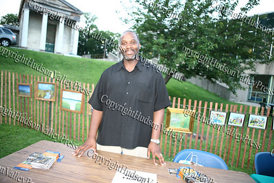 Charles Greene of Catholic Charities at their booth at the Newburgh Free Library during Newburgh's National Night Out.