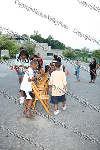 Children play musical chairs at Ebenezer Baptist Church during Newburgh's National Night Out.