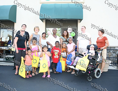 Independent Living employees pose with children and people from the community who stopped by their site during Newburgh's National Night Out.
