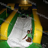 Children come down the inflatable slide during Newburgh's National Night Out.