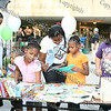 Children pick out free books at the Newburgh Free Library during Newburgh's National Night Out.