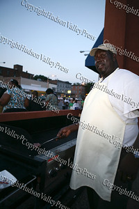 Deacon James Arline of the House of Refuge cooks up hamburger's and hot dogs during Newburgh's National Night Out.