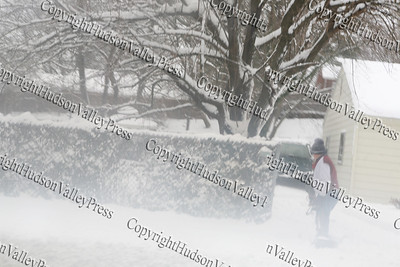 The first major snow storm of the 2008-2009 season, hit on Friday, December 19, 2008, left 10 inches of snow around the Hudson Valley. Homeowners use a snow blower to remove snow from the sidewalk.
