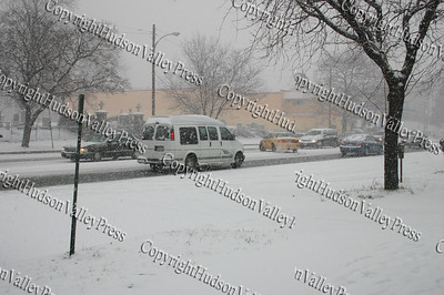 The first major snow storm of the 2008-2009 season, hit on Friday, December 19, 2008, left 10 inches of snow around the Hudson Valley.  A taxi cab in the City of Newburgh spins out on Broadway.