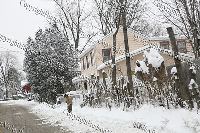 The first major snow storm of the 2008-2009 season, hit on Friday, December 19, 2008, left 10 inches of snow around the Hudson Valley. A homeowner clears the walkway in front of their home.