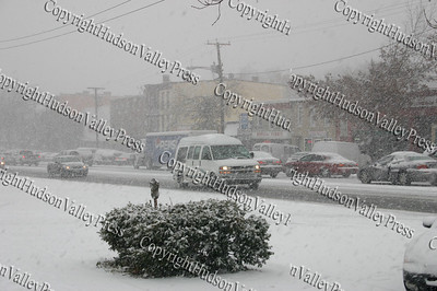 The first major snow storm of the 2008-2009 season, hit on Friday, December 19, 2008, left 10 inches of snow around the Hudson Valley. Motorist creep slowly on Broadway in the City of Newburgh.