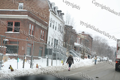 The first major snow storm of the 2008-2009 season, hit on Friday, December 19, 2008, left 10 inches of snow around the Hudson Valley. Pedestrians walk in the road which was clear on Dubois Street near St. Luke's Cornwall Hospital.