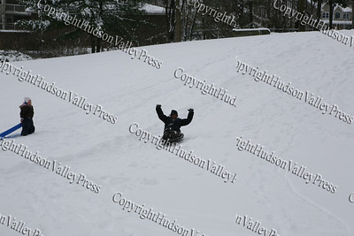 The first major snow storm of the 2008-2009 season, hit on Friday, December 19, 2008, left 10 inches of snow around the Hudson Valley. 10-year-old Austin sleds down a hill with his buddy  seven-year-old Kaelin.